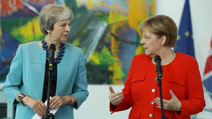 epa06865640 German Chancellor Angela Merkel (R) and British Prime Minister Theresa May (L) give statements to the media prior to their talks at the Chancellery in Berlin, Germany, 05 July 2018. Brexit was to be a major topic of their meeting. EPA/SEAN GALLUP / POOL