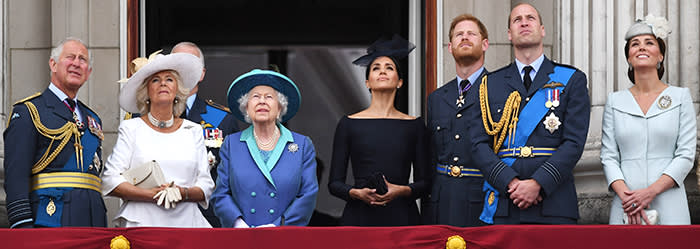 (left to right) Prince of Wales, Duke of York (obscured), the Duchess of Cornwall, Queen Elizabeth II, Duchess of Sussex, Duke of Sussex, Duke of Cambridge and Duchess of Cambridge on the balcony at Buckingham, Palace where they watched a Royal Air Force flypast over central London to mark the centenary of the Royal Air Force.. PRESS ASSOCIATION Photo. Picture date: Tuesday July 10, 2018. See PA story DEFENCE RAF100. Photo credit should read: Victoria Jones/PA Wire