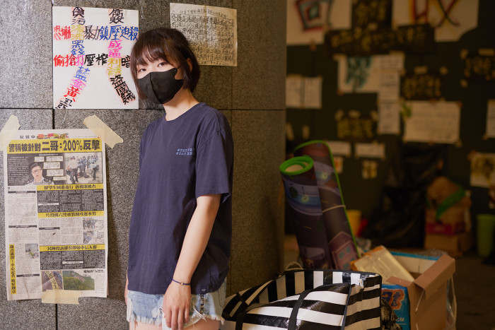 Christy, a student protester, mans a supply station during a 24 hour shift