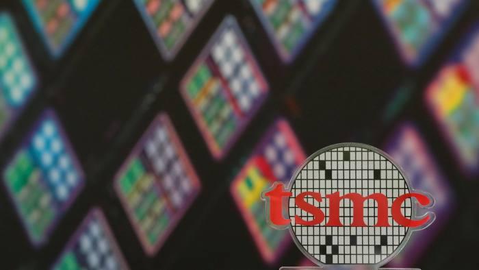Taiwan chipmaker TSMC cuts revenue forecast but is bullish
