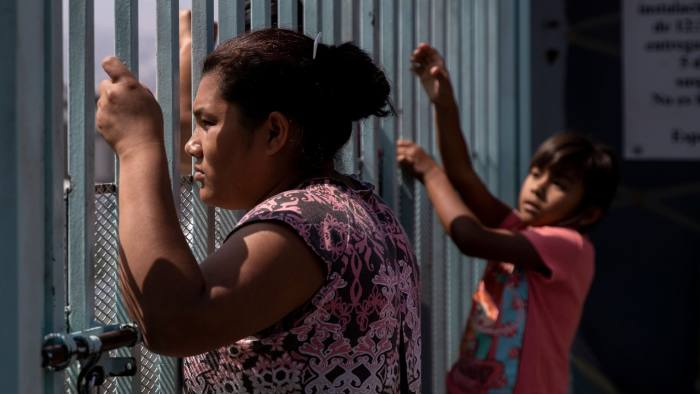 A Central American migrant looks on from a fence at Madre Assunta Institute, a shelter for migrant women and children in Tijuana, Baja California state, Mexico on July 13, 2019. - Asylum seekers in the US are overflowing shelters in Mexico waiting for their claims to be processed. (Photo by Eduardo Jaramillo Castro / AFP) (Photo credit should read EDUARDO JARAMILLO CASTRO/AFP/Getty Images)
