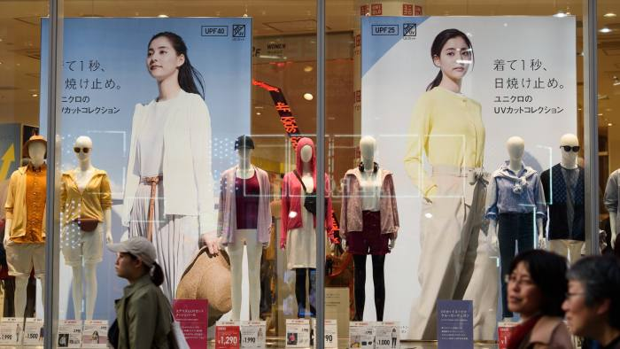 Pedestrians walk past mannequins on display at a Uniqlo store, operated by Fast Retailing Co., in Tokyo, Japan, on Saturday, April 6, 2019. Fast Retailing is schedule to release earnings figures on April 11. Photographer: Akio Kon/Bloomberg