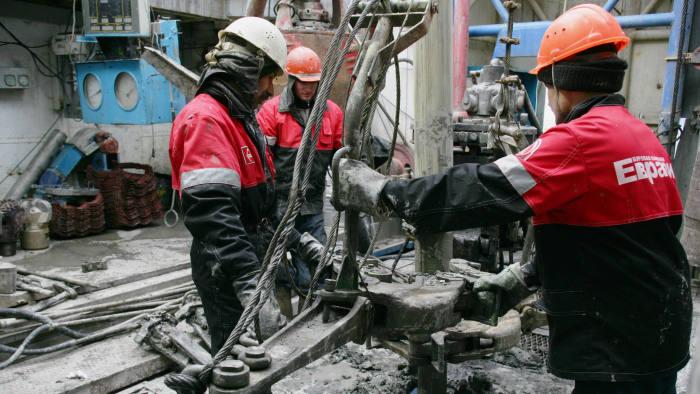 Workers seen at the Lukoil drilling rig in Druzhnoye, East Siberia, Friday, April 21, 2006. Photographer: Dmitry Beliakov/Bloomberg News.