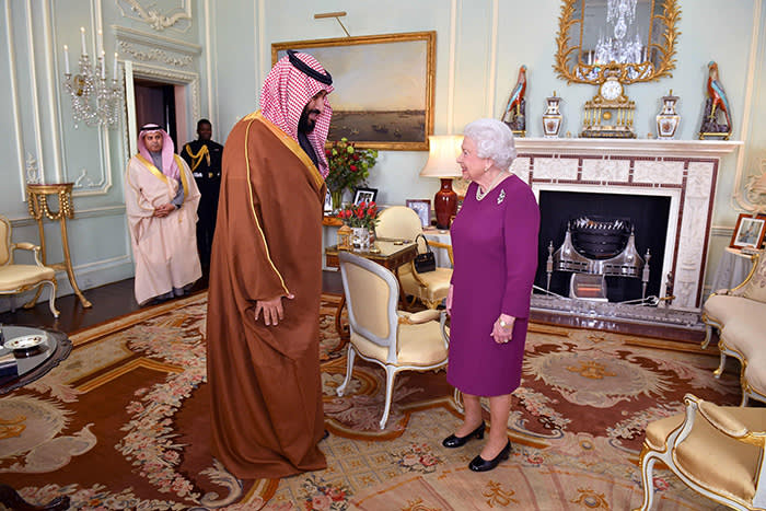 TOPSHOT - Britain's Queen Elizabeth II greets Saudi Arabia's Crown Prince Mohammed bin Salman at Buckingham Palace in central London on March 7, 2018. Salman, who is on a three day visit to the UK, will lunch Wednesday with the Queen at Buckingham Palace, while Prince Charles will host him at a dinner with Prince William among the guests. The crown prince will jointly host with May the inaugural UK-Saudi strategic partnership council in No. 10, the prime minister's office and residence. / AFP PHOTO / Dominic LipinskiDOMINIC LIPINSKI/AFP/Getty Images