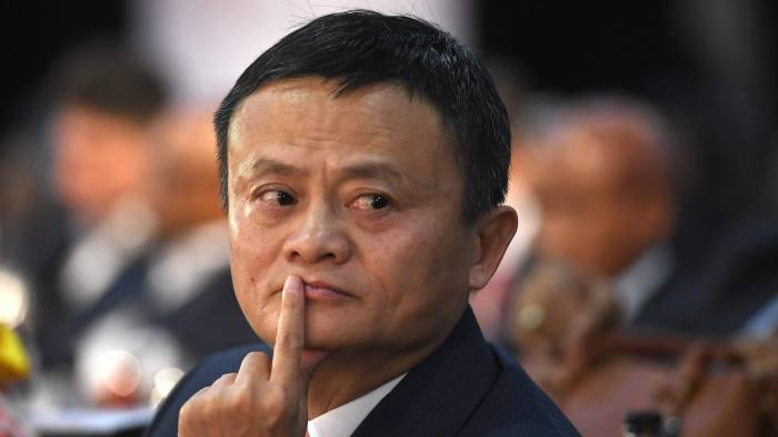 (FILE) This photo taken on October 26, 2018 shows co-founder of China's Alibaba Jack Ma gesturing as he attends an international investment conference in Johannesburg. - Jack Ma, founder of Chinese tech giant Alibaba, is among the world's richest people but he has now emerged as a member of another club: China's 89-million-strong Communist Party. In an article on November 26, the People's Daily said Ma was a party member who has played an important role in pushing China's Belt and Road global trade infrastructure initiative -- a pet project of President Xi Jinping. (Photo by STR / AFP)STR/AFP/Getty Images
