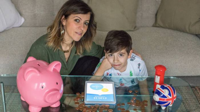 Lara Romanelli and her son Teo (8) at thier home in Maida Vale. 3/2/18 For FT Money. Children and Saving