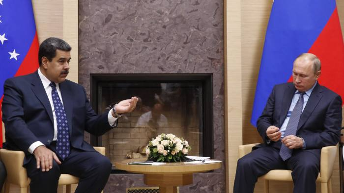 Venezuelan President Nicolas Maduro, left, gestures as he speaks to Russian President Vladimir Putin during meeting at the Novo-Ogaryovo residence outside in Moscow, Russia, Wednesday, Dec. 5, 2018. (Maxim Shemetov/Pool Photo via AP)