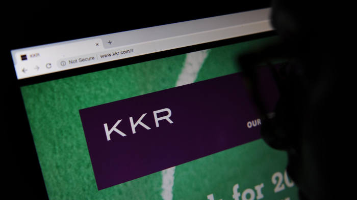 RGB7XM The private equity firm KKR & Co. Inc website seen through a magnifying glass