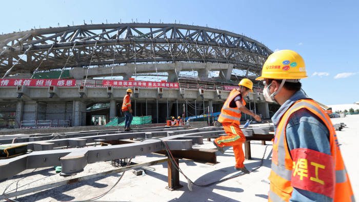 Workers are seen at the construction site of the National Speed Skating Oval, one of the venues for the 2022 Winter Olympics, in Beijing, China May 21, 2019. Picture taken May 21, 2019. China Daily via REUTERS ATTENTION EDITORS - THIS IMAGE WAS PROVIDED BY A THIRD PARTY. CHINA OUT. NO COMMERCIAL OR EDITORIAL SALES IN CHINA. - RC1D1C07D0C0