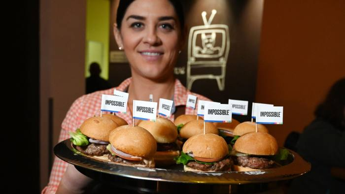 """The Impossible Burger 2.0, the new and improved version of the company's plant-based vegan burger that tastes like real beef is introduced at a press event during CES 2019 in Las Vegas, Nevada on January 7, 2019. - The updated version can be cooked on a grill and has a better flavor and lowered cholesterol, fat and calories than the original. """"Unlike the cow, we get better at making meat every single day,"""" CEO of Impossible Foods CEO Pat Brown. (Photo by Robyn Beck / AFP)ROBYN BECK/AFP/Getty Images"""