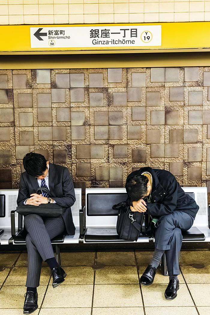 WAB0GC Japan, Honshu, Tokyo, Sleeping Passengers Waiting for Train on Subway Station, 30076275