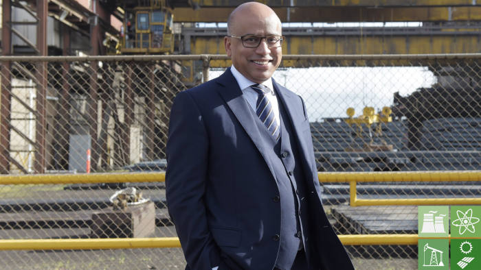 Sanjeev Gupta, executive chairman of Liberty House Group, poses for a photograph in front of the billet yard at Arrium Ltd.'s OneSteel plant in Melbourne, Australia, on Wednesday, July 19, 2017. GFG Alliance, led byGupta, this month reached a deal to purchase the steel and iron ore assets ofArrium, the Australian mill that's been in administration for more than a year. Photographer: Carla Gottgens/Bloomberg