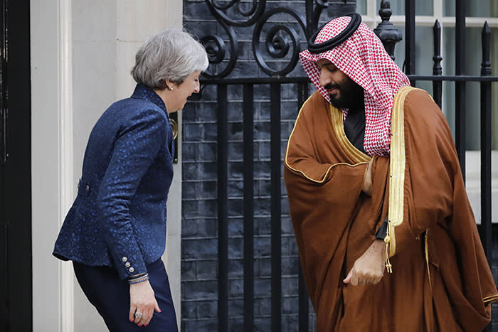 "TOPSHOT - Britain's Prime Minister Theresa May (L) greets Saudi Arabia's Crown Prince Mohammed bin Salman (R) outside 10 Downing Street, in central London on March 7, 2018. British Prime Minister Theresa May will ""raise deep concerns at the humanitarian situation"" in war-torn Yemen with Saudi Crown Prince Mohammed bin Salman during his visit to Britain beginning Wednesday, according to her spokesman. / AFP PHOTO / Tolga AKMENTOLGA AKMEN/AFP/Getty Images"