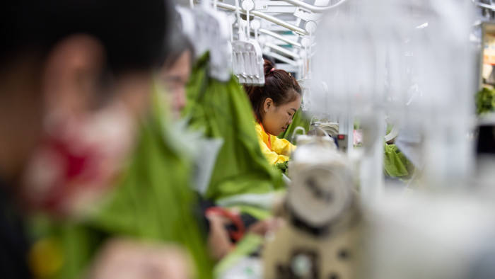 Employees use sewing machines at the Pan-Pacific Co. Viet Pacific Clothing (VPC) factory in Vo Cuong, Bac Ninh province, Vietnam, on Friday, March 1, 2019. Pan Pacific manufactures and exports feather-down products, apparel, bedding goods, and needlework products. Photographer: SeongJoon Cho/Bloomberg via Getty Images