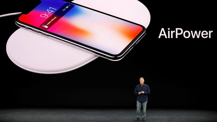 FILE PHOTO: Apple Senior Vice President of Worldwide Marketing, Phil Schiller, shows the AirPower wireless charging mat during a launch event in Cupertino, California, U.S. September 12, 2017. REUTERS/Stephen Lam/File Photo