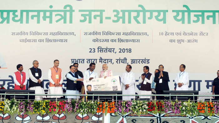 RANCHI, INDIA - SEPTEMBER 23: Prime Minister Narendra Modi gives a health card to beneficiaries as he launches Ayushman Bharat-National Health Protection Scheme, at Prabhat Tara Ground, at Dhurwa, on September 23, 2018 in Ranchi, India. Prime Minister Narendra Modi launched the Ayushman Bharat Pradhan Mantri Jan Aarogya Yojana (AB-PMJAY)' scheme, deemed as the world's largest government-funded healthcare programme covering over 50 crore beneficiaries. (Photo by Parwaz Khan/Hindustan Times via Getty Images)