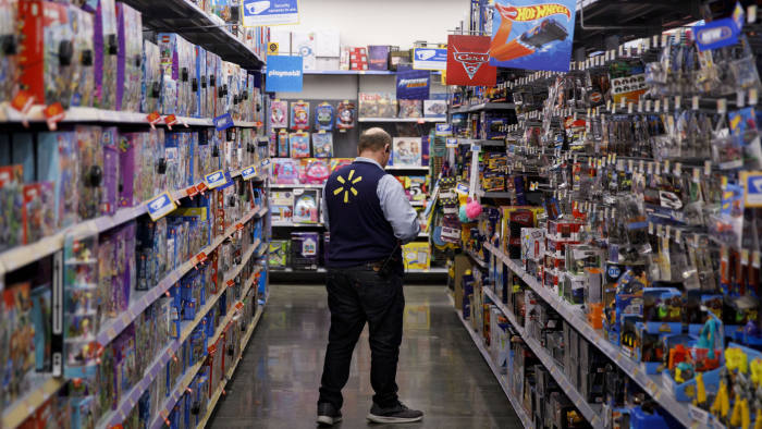An employee scans toys at a Walmart Inc. store in Burbank, California, U.S., on Monday, Nov. 19, 2018. To get the jump on Black Friday selling, retailers are launching Black Friday-like promotions in the weeks prior to the event since competition and price transparency are forcing retailers to grab as much share of the consumers' wallet as they can. Photographer: Patrick T. Fallon/Bloomberg