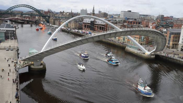 A flotilla of fishing boats by the Gateshead Millennium Bridge in Newcastle, in a protest, organised by Campaign for an Independent Britain and Fishing for Leave, against the deal that will see the UK obeying the EU Common Fisheries Policy for the transition period of Brexit. PRESS ASSOCIATION Photo. Picture date: Sunday April 8, 2018. Photo credit should read: Owen Humphreys/PA Wire