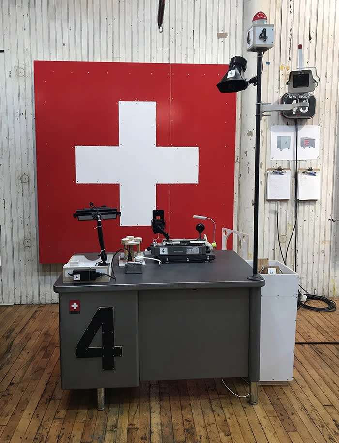 Tom Sachs 'Swiss Passport Office' Tom Sachs Studio, 2018 Representative of how the work will be installed at Ropac.