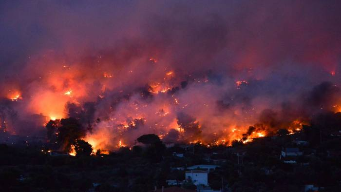 TOPSHOT - Flames rise as a wildfire burns in the town of Rafina, near Athens, on July 23, 2018.  / AFP PHOTO / ANGELOS TZORTZINISANGELOS TZORTZINIS/AFP/Getty Images
