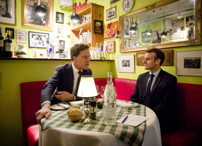 epa06619010 French President Emmanuel Macron (R) has dinner with Dutch Prime Minister Mark Rutte (L) at the Bistrot Deux La Place restaurant during his visit in The Hague, The Netherlands, 21 March 2018. EPA/BART MAAT