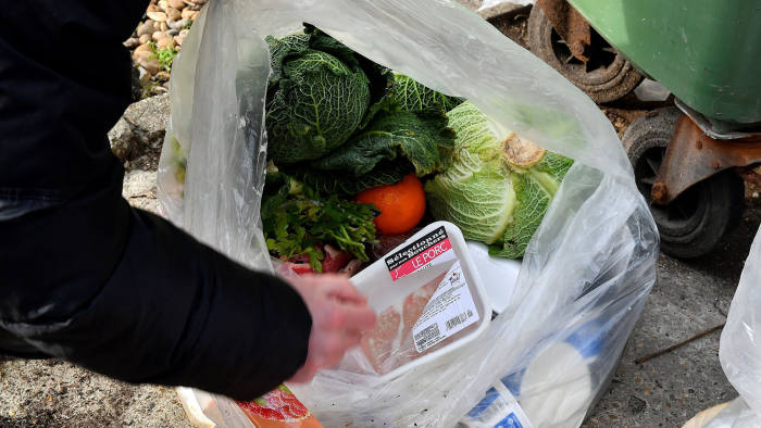 A French bailiff records the waste of food in the dustbin of Leclerc supermaket in Mimizan-Plage, southwestern France on February 4, 2019 as a claim is to be filed. (Photo by GEORGES GOBET / AFP) (Photo credit should read GEORGES GOBET/AFP via Getty Images)