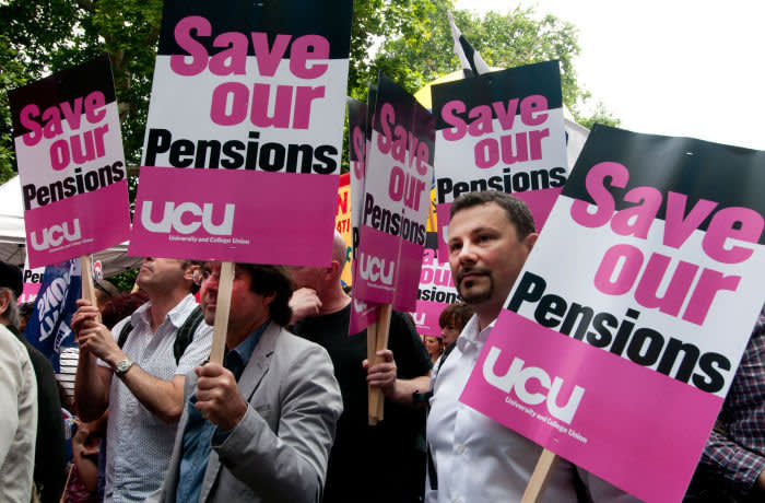 C50TRK One day strike by teachers and civil servants to protest at changes in pensions- group of members of UCU union with placards