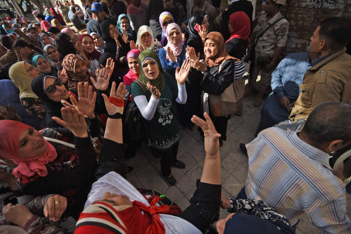 Egyptian voters dance and celebrate while queuing up outside a polling station on the first day of the 2018 presidential elections, in al-Haram neighbourhood in the capital Cairo's southwestern Giza district on March 26, 2018. Egyptians head to the polls in a three-day vote to choose between incumbent Abdel Fattah al-Sisi and little-known candidate Moussa Mostafa Moussa, who has struggled to make the case he is not Sisi's minion. / AFP PHOTO / MOHAMED EL-SHAHEDMOHAMED EL-SHAHED/AFP/Getty Images