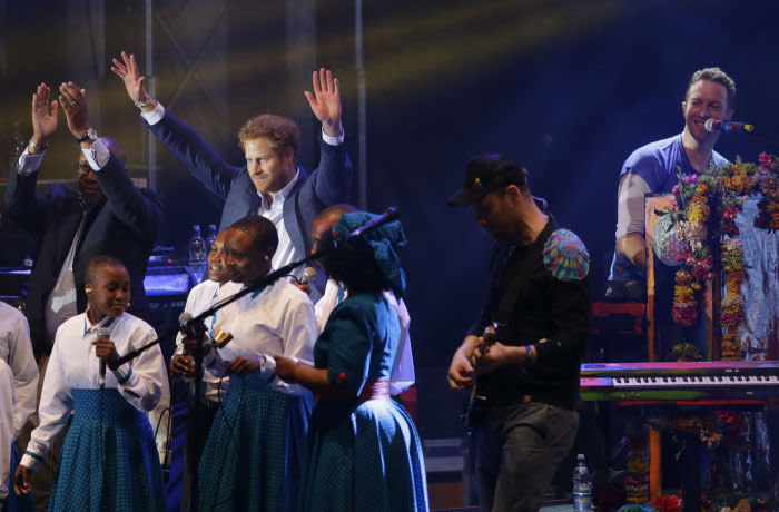 LONDON, ENGLAND - JUNE 28: Prince Harry is seen on stage with Chis Martin of Coldplay during the final performance at the Sentebale Concert at Kensington Palace on June 28, 2016 in London, England. Sentebale was founded by Prince Harry and Prince Seeiso of Lesotho over ten years ago. It helps the vulnerable and HIV positive children of Lesotho and Botswana. (Photo by Matt Dunham - WPA Pool/Getty Images)