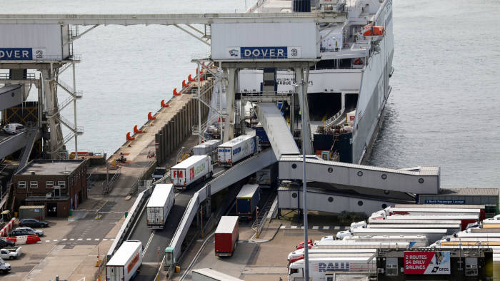 Lorries embark a DFDS AS ferry at the Port of Dover Ltd., U.K. in Dover, on Tuesday, Aug. 1, 2017. Customschecks at the border after the U.K. leaves the European Union could cost 1 billion pounds ($1.3 billion) a year and cause delays for goods being shipped in both directions, according to a report by Oxera, an economic consultancy. Photographer: Chris Ratcliffe/Bloomberg