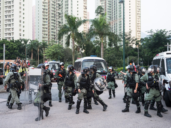 Police in full riot gear gather in the port area of Tung Chung, Lantau Island. Although there have been no confirmed deaths, violent clashes between police and protesters have escalated recently
