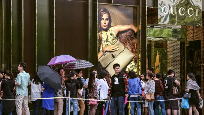 SHANGHAI, CHINA - MAY 27:  (CHINA OUT) Customers wait outside Gucci Store in Golden Eagle Shopping Center on Shanxi North Road to enjoy Gucci's 50% discount on May 27, 2015 in Shanghai, China. It was said that luxuries as Chanel, Cartier had cut price in China before and Gucci had also reduced their price of most articles with fifty percent discount in China on May 27.  (Photo by VCG/VCG via Getty Images)