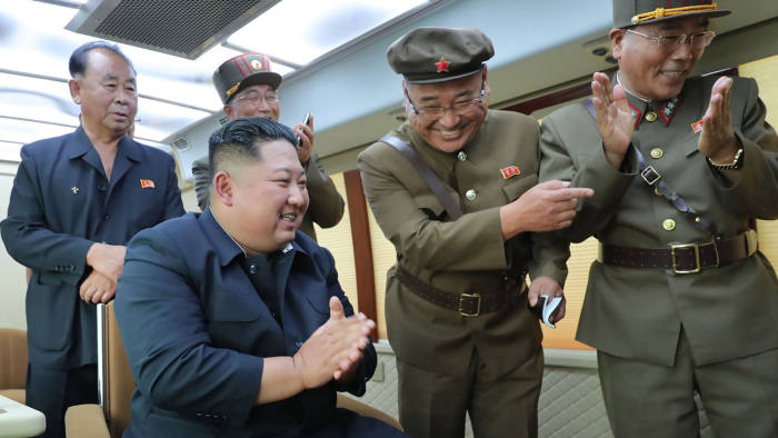 """TOPSHOT - This picture taken on August 16, 2019 and released on August 17 by North Korea's official Korean Central News Agency (KCNA) shows North Korean leader Kim Jong-Un (seated) celebrating the successful test-firing of a new weapon, presumed to be two short-range ballistic missiles, at an undisclosed location. - North Korea fired what appeared to be two short-range missiles into the sea on August 16 and launched a scathing attack on """"foolish"""" calls for dialogue from South Korean President Moon Jae-in, rejecting further peace talks with Seoul. (Photo by KCNA VIA KNS / KCNA VIA KNS / AFP) / South Korea OUT / ---EDITORS NOTE--- RESTRICTED TO EDITORIAL USE - MANDATORY CREDIT """"AFP PHOTO/KCNA VIA KNS"""" - NO MARKETING NO ADVERTISING CAMPAIGNS - DISTRIBUTED AS A SERVICE TO CLIENTS / THIS PICTURE WAS MADE AVAILABLE BY A THIRD PARTY. AFP CAN NOT INDEPENDENTLY VERIFY THE AUTHENTICITY, LOCATION, DATE AND CONTENT OF THIS IMAGE --- / KCNA VIA KNS/AFP/Getty Images"""