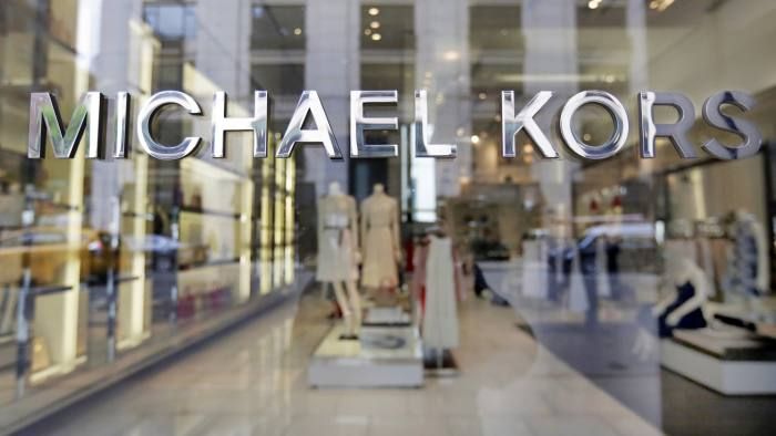 FILE- In this May 31, 2017, file photo the Michael Kors name adorns his store on Madison Avenue, in New York. Michael Kors Holdings Ltd. reports earnings, Wednesday, Nov. 7, 2018. (AP Photo/Richard Drew, File)
