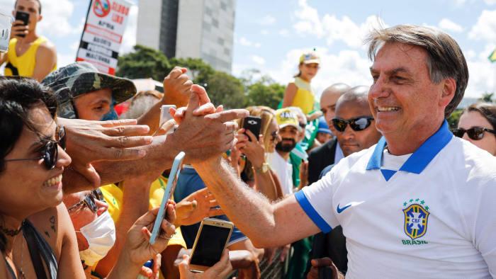 Bolsonaro defies coronavirus to rally against Congress | Financial ...