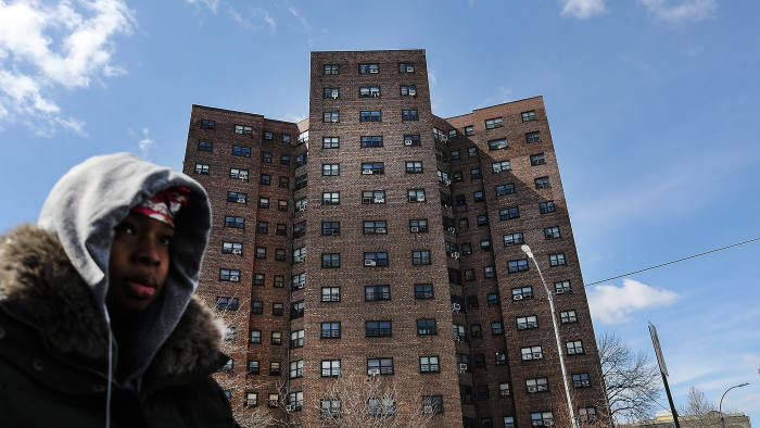 NEW YORK, NY - MARCH 16: A woman walks by the Farragut Houses, a public housing project in Brooklyn on March 16, 2017 in New York City.The budget blueprint President Donald Trump released Thursday calls for the cutting of billions of dollars in funding from the Department of Housing and Urban Development. This is despite a campaign pledge Trump made to help rebuild the nation's inner city communities. (Photo by Spencer Platt/Getty Images)