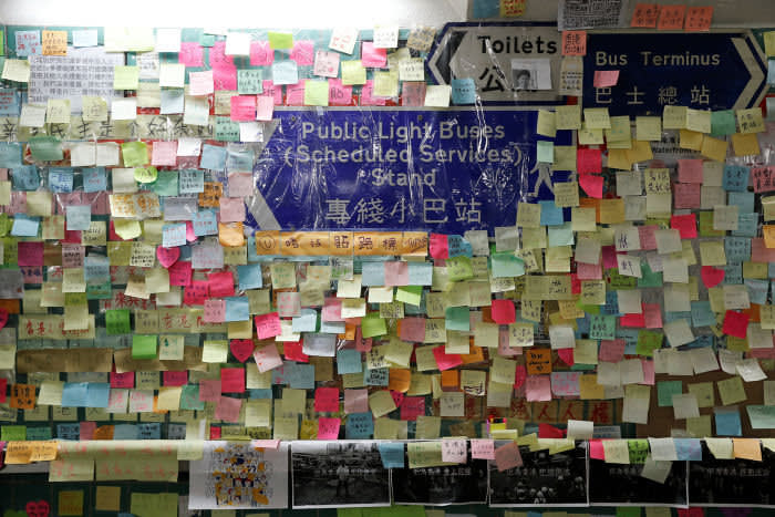 Memos and notices on a 'Lennon Wall' at Tai Po