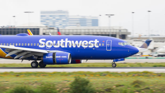 LOS ANGELES INTERNATIONAL AIRPORT, CA/USA - MARCH 7, 2018: Southwest Airlines jet shown landing at LAX.; Shutterstock ID 1071033323; Department: -; Job/Project: -; Employee Name: -