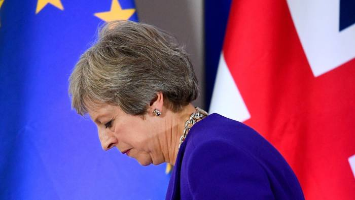 Britain's Prime Minister Theresa May leaves after a news conference at the European Union leaders summit in Brussels, Belgium October 18, 2018. REUTERS/Toby Melville