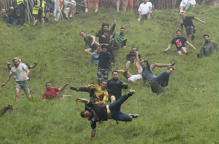 PABest Competitors take part in the annual cheese rolling competition at Cooper's Hill in Brockworth, Gloucestershire. PRESS ASSOCIATION Photo. Picture date: Monday May 28, 2018. Photo credit should read: Aaron Chown/PA Wire