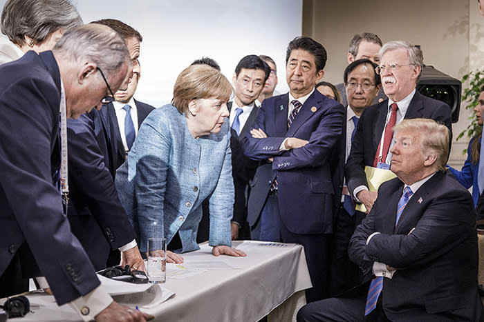 HANDOUT - HANDOUT - German Chancellor Angela Merkel (C) speaks with US President Donald Trump (R) in presence of French President Emmanuel Macron (2-l), Japanese Prime Minister Shinzo Abe (4-R), and US National Security Advisor John Bolton (2-R) during a meeting on the sidelines of the G7 Summit in La Malbaie, Canada, 09 June 2018. HANDOUT EDITORIAL USE ONLY/NO SALES Photo: Jesco Denzel/Bundesregierung /dpa - Use only with the written agreement