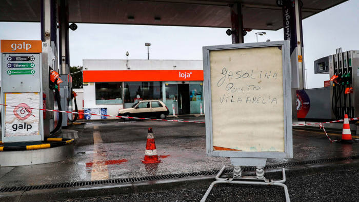 A closed gas station due to the national strike of hazardous goods lorry drivers, is pictured on April 17, 2019 in Seixal, in the outskirts of Lisbon. - Many Portuguese were queuing at the few gas stations where it was still possible to refuel despite the shortages caused by a strike of the fuel carriers. (Photo by CARLOS COSTA / AFP)CARLOS COSTA/AFP/Getty Images