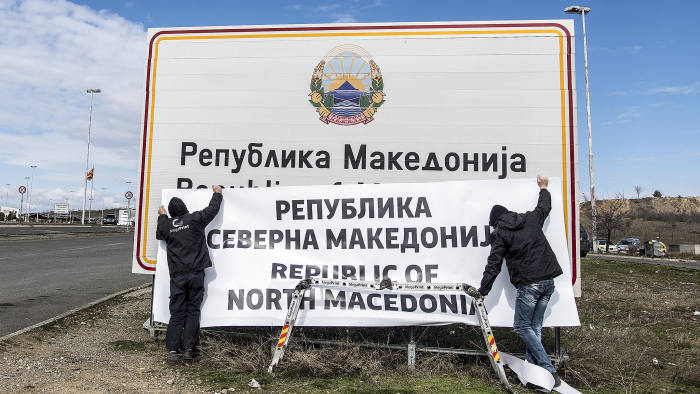 People are at work to change boards at the border between Macedonia and Greece near Gevgelija on February 13, 2019. - The deal between Skopje and Athens to rename Macedonia as North Macedonia came into force on February 12, 2019 after constitutional changes were published in the Official Gazette, the government said in a statement. Since 1991, Athens had objected to its neighbour being called Macedonia because Greece has a historic northern province of the same name. Greece has blocked Macedonia's NATO and EU integration until it changes the name. (Photo by Robert ATANASOVSKI / AFP) (Photo credit should read ROBERT ATANASOVSKI/AFP/Getty Images)