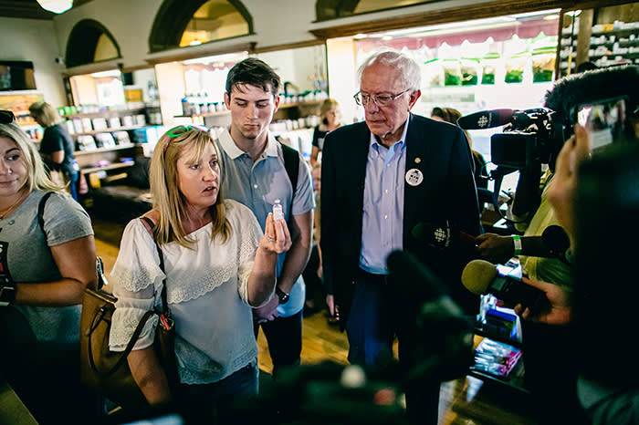 Kathy Segos and her son Hunter discuss insulin rationing with Bernie Sanders in July. Kathy pays $1,200 a month for Hunter's insulin – it is the household's single-biggest expense