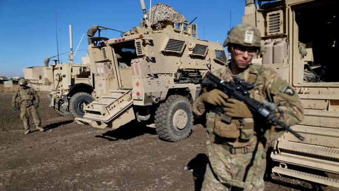 US. army soldiers stand next a military vehicle in the town of Bartella, east of Mosul, Iraq, December 27, 2016. Picture taken December 27, 2016. REUTERS/Ammar Awad - RC1C4F205D90