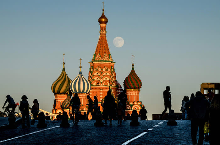TOPSHOT - A picture shows the moon over Saint Basil's Cathedral on the Red Square in Moscow on May 28, 2018. / AFP PHOTO / Mladen ANTONOVMLADEN ANTONOV/AFP/Getty Images