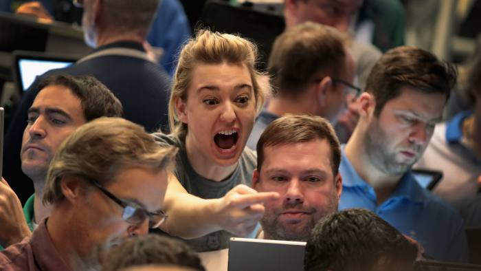 CHICAGO, IL - FEBRUARY 06: Traders signal offers in the S&P options pit at the Cboe Global Markets, Inc. exchange (previously referred to as CBOE Holdings, Inc.) on February 6, 2018 in Chicago, Illinois. Yesterday the S&P 500 and Dow Industrials indices closed down more than 4.0 percent, the biggest single-day percentage drops since August 2011. (Photo by Scott Olson/Getty Images)