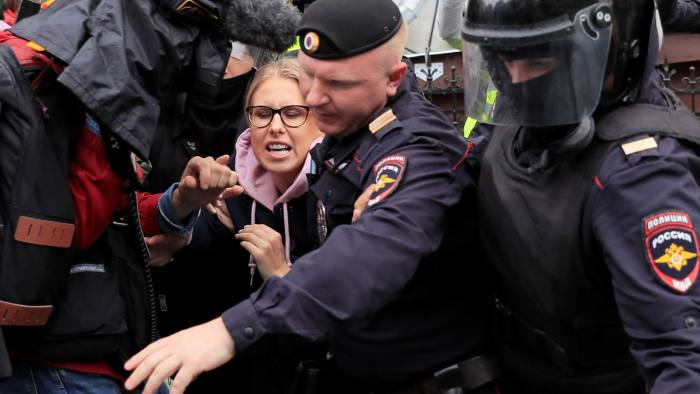 Law enforcement officers detain Russian opposition politician Lyubov Sobol before a rally calling for opposition candidates to be registered for elections to Moscow City Duma, the capital's regional parliament, in Moscow, Russia August 3, 2019. REUTERS/Tatyana Makeyeva