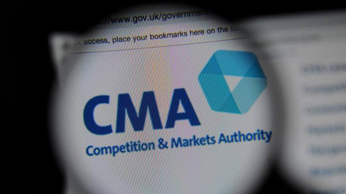 PRAE07 The Competition and Markets Authority (CMA) website seen through a magnifying glass