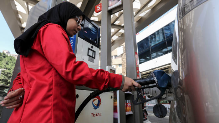 A female employee fills the tank of a car at a petrol station in Cairo, Egypt, February 24, 2016. A petrol station in the Egyptian capital Cairo hires women to work as attendants - until now, petrol stations were staffed almost exclusively by men. Picture taken February 24, 2016. REUTERS/Mohamed Abd El Ghany - GF10000326794